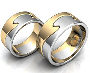 Пара оригинальных обручальных колец из красного и белого золота