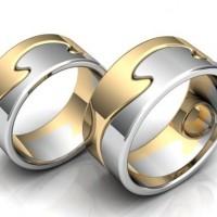 Пара обручальных колец из красного и белого золота