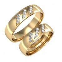 Пара обручальных колец из красного золота с бриллиантами